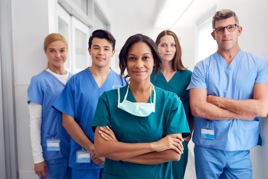 Medical Team Standing In Hospital Corridor