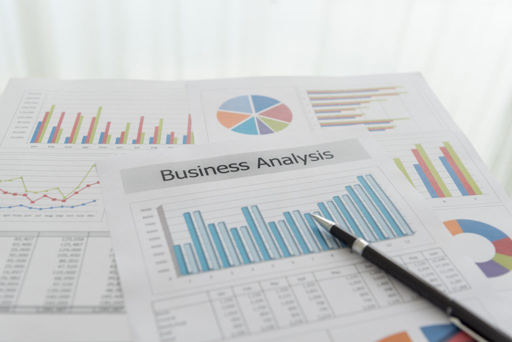 Business analysis report, Financial graph and chart summary report on desk.
